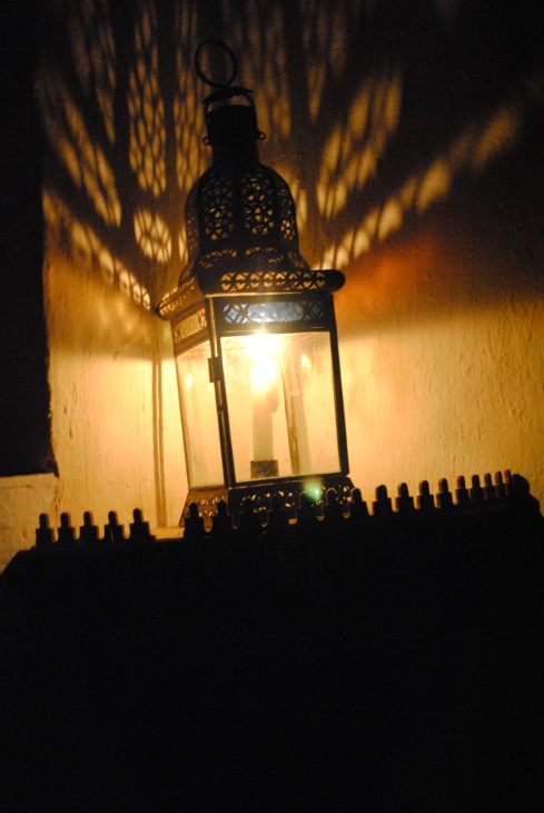 candle in moroccan lamp